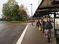 People waiting for a bus at Borås bus station.jpg