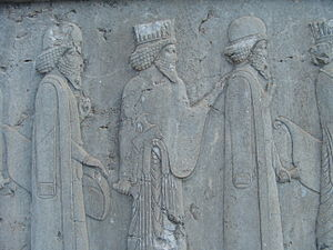 Kandys - Detail of a relief showing two men (left and right) wearing kandys. Apadana of Persepolis, 550-330 BC.