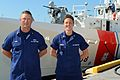 Petty Officers Andrew Bowe and Hali Lombardi stand in front of the USCGC Charles Sexton, moored in Key West, their hometown.jpg