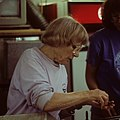 Photo of Ruth Turner dissecting clams from the deep sea (cropped).jpg