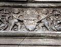 Piazza cattaneo, portale in pietra nera con medaglioni di imperatori e fregio con girali, delfini, e putti reggistemma, xvi secolo 04.jpg