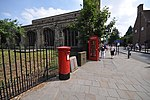 Pillar box and red telephone box in front of St Clement's Church, Cambridge.jpg