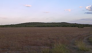 Eroded core of an extinct volcano located 8 miles (13 km) south of central Austin, Texas