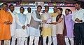 Piyush Goyal and the Chief Minister of Madhya Pradesh, Shri Shivraj Singh Chouhan distributing the LED Bulbs to the citizens at the launch of the UJALA Scheme in Madhya Pradesh, at Bhopal.jpg
