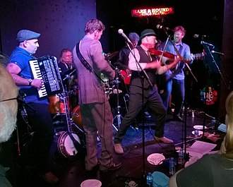 Police Dog Hogan - The band performing in Birmimgham in 2015.  Left to right: Shahen Galichian, Michael Giri, Tim Dowling, Don Bowen, Eddie Bishop, James Studholme