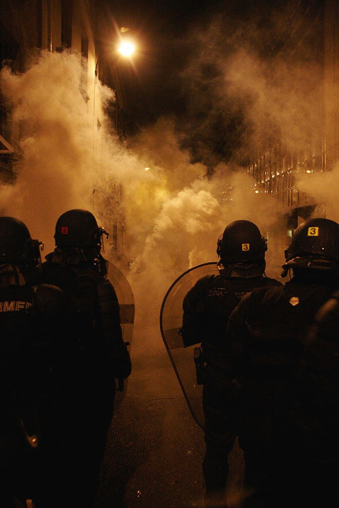 Police fighting against anti-Sarkozy with tear gas (487645695)