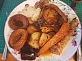 Pork Chop with roast potatoes, carrot & parsnip, cauliflower cheese, yorkshire puddings & redcurrant jelly (33873719958).jpg