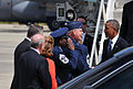 President Barack Obama, right, shakes hands with U.S. Air Force Col. Marshall C. Collins, the commander of the 145th Airlift Wing, North Carolina Air National Guard, upon arriving at the North Carolina Air 140826-Z-FY745-145.jpg