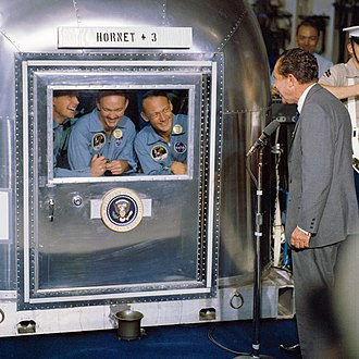 Space policy of the United States - Image: President Nixon welcomes the Apollo 11 astronauts aboard the U.S.S. Hornet