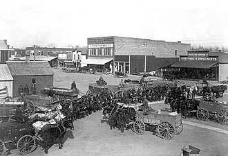 Protection, Kansas - Wheat wagons on Broadway Avenue, 1913