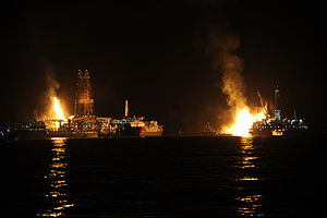 Q4000 - Q4000 and Discoverer Enterprise flare off gas at the site of drilling operations at the Deepwater Horizon response site in the Gulf of Mexico at night 8 July 2010.
