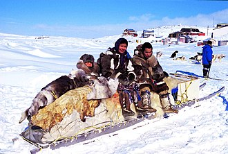 Indigenous peoples of the Americas - Some Inuit people on a traditional qamutiik (dog sled) in Cape Dorset, Nunavut, Canada