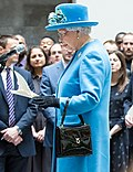 Queen Elizabeth II with a Launer handbag
