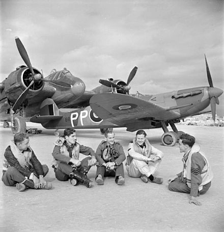 Five Malta-based RAF pilots sitting in front of a Beaufighter and a Spitfire at RAF Luqa, January 1943 RAF pilots with Beaufighter and Spitfire at Malta 1943.jpg