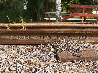 Rail profile - Rail from 1896 showing manufacturer's name and specification formed onto the web of rail during rolling.