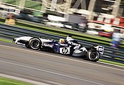 Ralf Schumacher driving for the WilliamsF1 team Model FW25 at the 2003 United States Grand Prix. The German qualified in fifth position before he span off on after completing 21 laps.