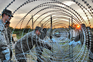 Concertina wire Type of barbed wire