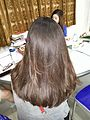 Rear view of woman with long brown hair 01.jpg