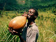 man drinking wine from gourd