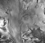 Rendu Glacier, tidewater glacier and mountain glaciers partially obscurred by clouds, September 17, 1966 (GLACIERS 5823).jpg