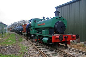 """Rutland Railway Museum - Andrew Barclay """"Sir Thomas Royden"""" with a train of mineral wagons."""