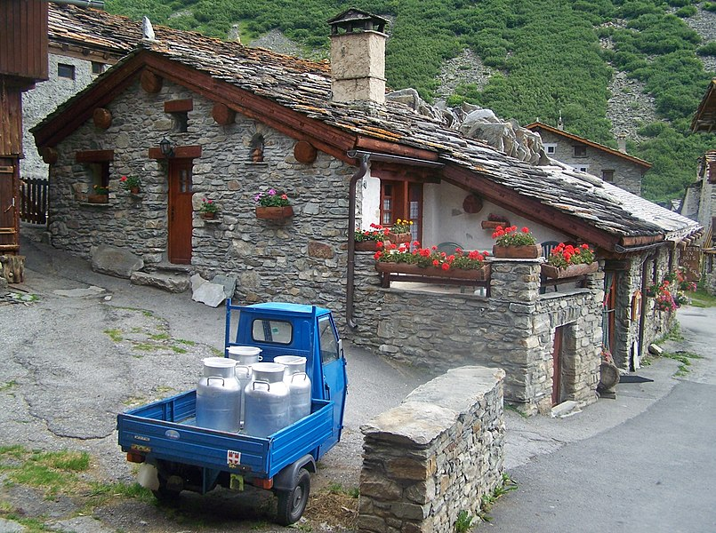Sight of a street with houses and milk cans in the village of Bonneval-sur-Arc, the very last one at the end of the Maurienne valley in Savoie, France.