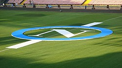 SSC Napoli logo on the pitch of the Stadium San Paolo.jpg