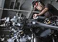 Sailor inspect an MH-60R aboard USS Nimitz. (9606214345).jpg