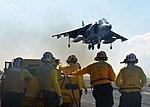 Sailors watch an AV-8B Harrier aircraft landing on the flight deck of USS Bataan. (29709785171).jpg