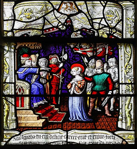 Agatha in front of the judge as depicted in a stained glass window from 1515 in Notre-Dame, Saint-Lo Saint-Lo Eglise Notre-Dame Vitrail Baie 17 Jugement de sainte Agathe 2019 08 19.jpg