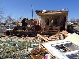 An image depicting the remains of a destroyed double-wide mobile home in Sand Springs, Oklhoma.