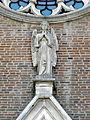 Santa Maria Assunta, angelo su portale e rosone (Arre).JPG