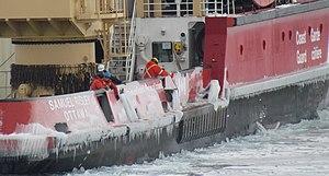 Scraping ice from the icebreaker CCGS Samuel Risley.jpg