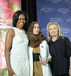 Secretary Clinton and First Lady Obama With 2012 IWOC Award Winner Hana El Hebshi of Libya.png