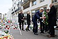 Secretary Kerry Picks Up a Wreath to Lay at Site of Last Week's Shooting at the Headquarters of Charlie Hebdo (16106123669).jpg