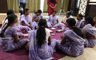 National Rural Livelihood Mission - A model self-help group demonstrating at a seminar in Maharashtra.