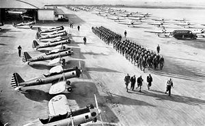United States Army Air Forces Contract Flying School Airfields - Flight Cadets Marching along Flight Line in front of their Fairchild PT-19 trainers at Sequoia Field, California in 1943.  Richard Bong, the United States' highest-scoring air ace in World War II, learned to fly at Sequoia Field in 1942.