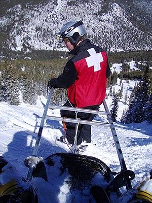 Ski patrol - Ski patroller with toboggan in tow