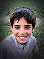Smiling Iranian boy, Chaharmahal and Bakhtiari Province, Iran, 09-16-2006.jpg