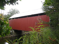 Snyder Covered Bridge No. 17 crossing Roaring Creek in Locust Township