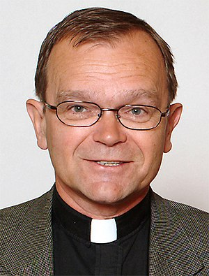 Clerical collar - Church of Sweden Lutheran minister Sven-Erik Brodd wearing a clerical shirt with a tab collar.