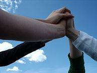 Team touching hands