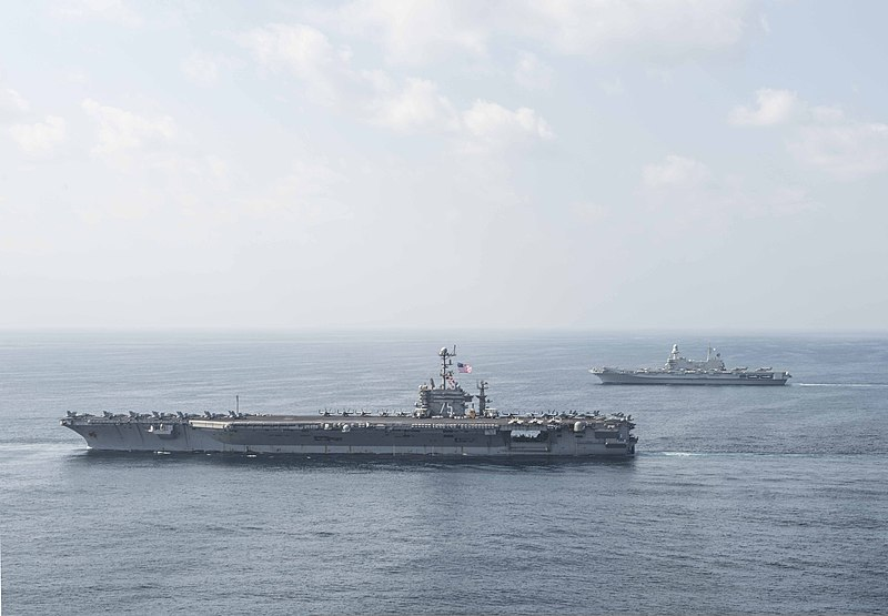 File:The Italian Navy aircraft carrier ITS Cavour (CVH 550), top, sails alongside the aircraft carrier USS Harry S. Truman (CVN 75) in the Gulf of Oman Jan. 3, 2014 140103-N-CL550-332.jpg