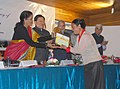 The Minister of State for Commerce & Industry (Independent Charge), Smt. Nirmala Sitharaman presenting the Large Cardamom Productivity award to the winning farmer, in Nacheybong, Gangtok (1).jpg