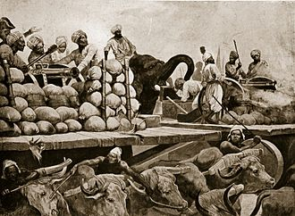 Battle of Plassey - The Nawab's artillery on movable platform. A large stage, raised six feet from the ground, carrying besides the cannon, all the ammunition belonging to it, and the gunners themselves who managed the cannon, on the stage itself. These machines were drawn by 40 or 50 yoke of white oxen, of the largest size, bred in the country of Purnea; and behind each cannon walked an elephant, trained to assist at difficult tugs, by shoving with his forehead against the hinder part of the carriage.