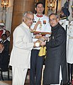 The President, Shri Pranab Mukherjee presenting the Padma Bhushan Award to Shri Needamangalam Gopalaswami, at a Civil Investiture Ceremony, at Rashtrapati Bhavan, in New Delhi on March 30, 2015.jpg