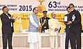 The President, Shri Pranab Mukherjee presenting the Rajat Kamal Award to Shri Amitabh Bachhan (Best Actor) for Piku, at the 63rd National Film Awards Function, in New Delhi.jpg