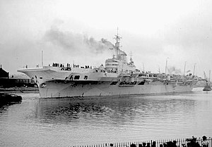 HMS Implacable (R86) - Implacable being towed down the Clyde, 1944