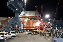 The boathouse of USS Zumwalt is moved into position. (8291331134).jpg