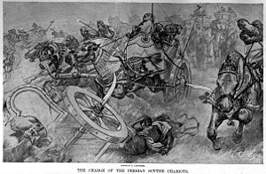 The charge of the Persian scythed chariots at the Battle of Gaugamela, by Andre Castaigne (1898-1899).